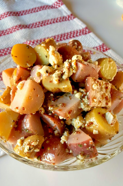 This Red White and Blue Cheese Potato Salad is a French style spin on a summer picnic favorite that your guests will love!