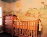 Lyra Nursery 1 of 2 - The beautiful mural in this nursery creates a soft, cozy atmosphere for the baby and her parents. The colors in the crib bedding complement the colors in the mural.