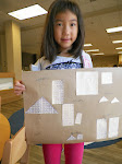 Students learn about geometry with many different materials. Here, a student has cut out geometric shapes, and labeled them as equivalent, similar or congruent.