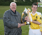 John Graham presents the Michael Kellett Cup to Clontibret captain Shane Mulligan. Photo by Philip Fitzpatrick
