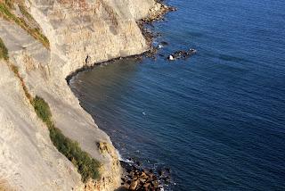 Steep cliffs to the sea below