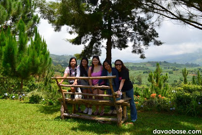 Female bloggers posing on a breathtaking scenery of Kapatagan, from inside Camp@Tagan Hillside