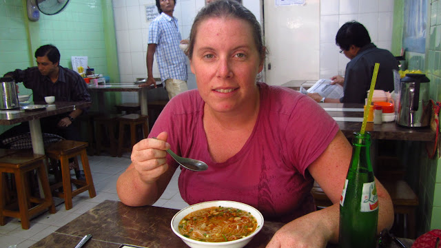 Heather enjoying a Shan noodle soup with Fantasy Lemon soda in Yangon, Burma.