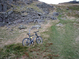Bike at bottom of ascent to Hard Knott