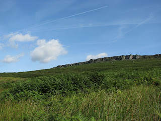 Vapour Trail over Stanage Edge