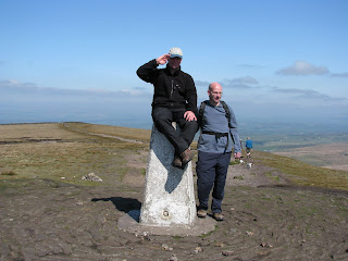 Richard salutes on top of Pendle Hill Trig Point