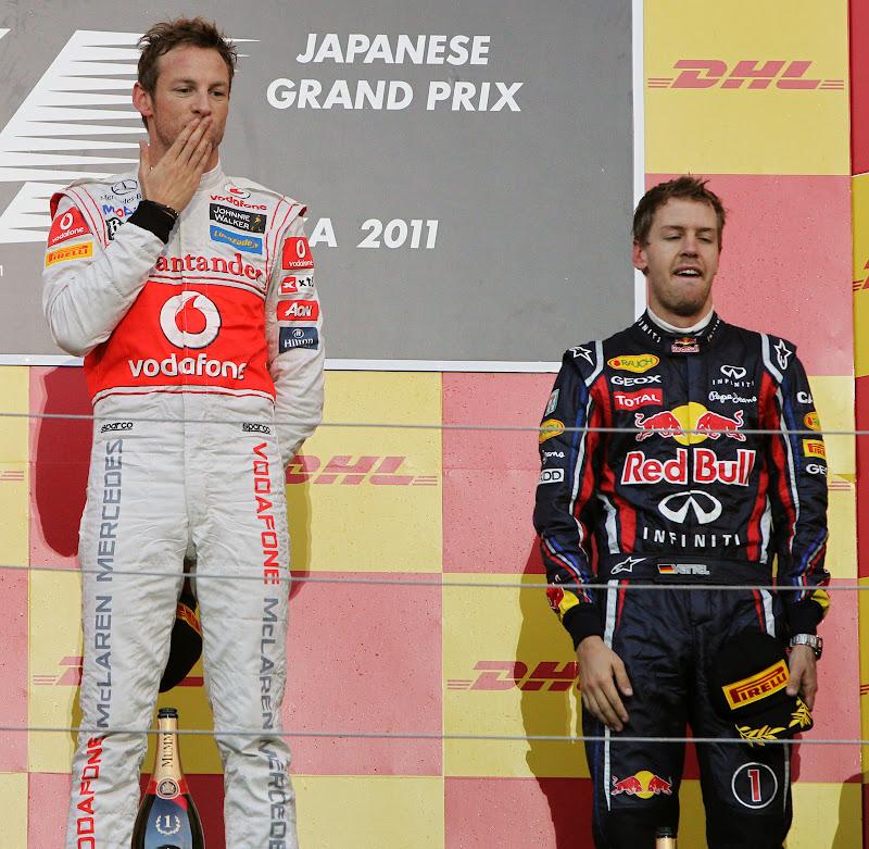 Дженсон Баттон и Себастьян Феттель на подиуме Сузуки на Гран-при Японии 2011