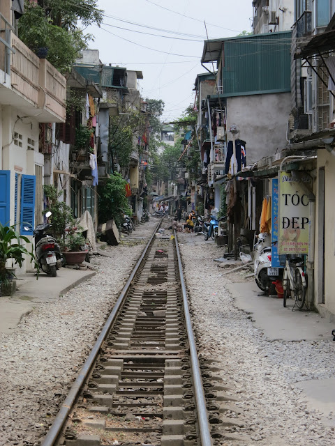 Vietnam has the distinction of running the slowest trains in the world. With trackside development like this it's not hard to see why...
