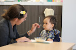 LePort Private School Irvine - Montessori infant teacher feeding baby