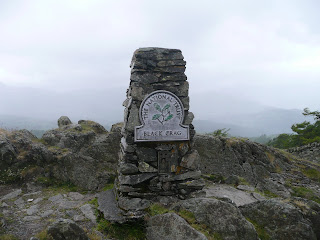 Black Crag Trig Point (on a very wet and windy day)
