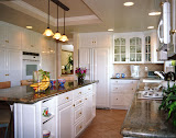 Simpson Kitchen - This kitchen was dramatically transformed with the addition of new cabinetry, appliances, and granite countertops. The overhead and under-cabinet lighting create a warm glow.
