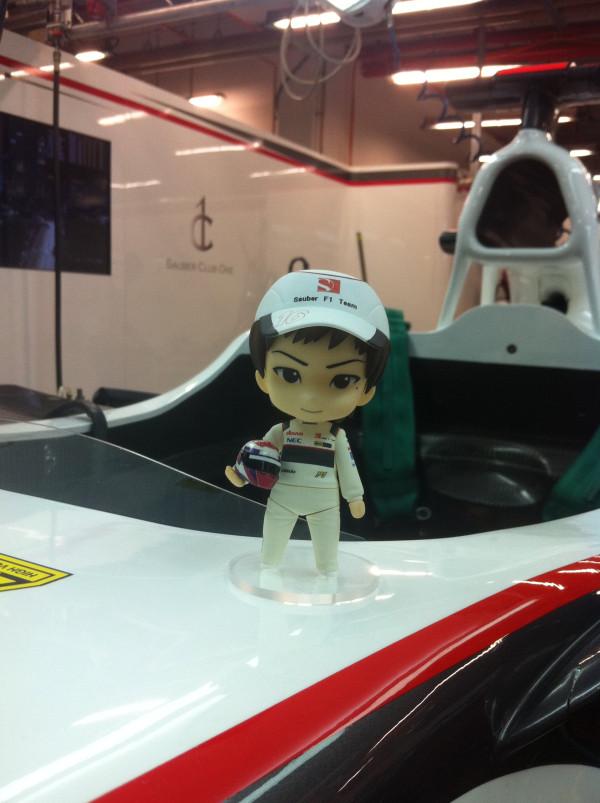фигурка Камуи Кобаяши на болиде Sauber на Гран-при Сингапура 2011