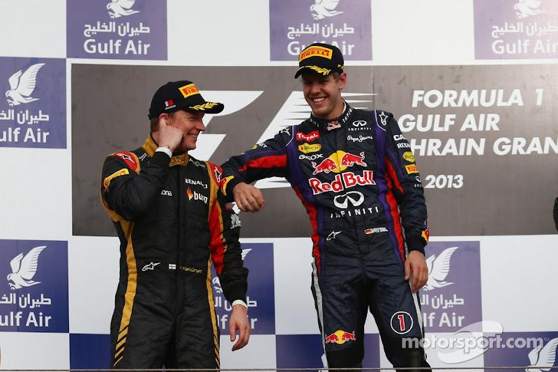 Кими Райкконен и Себастьян Феттель на подиуме Гран-при Бахрейна 2013
