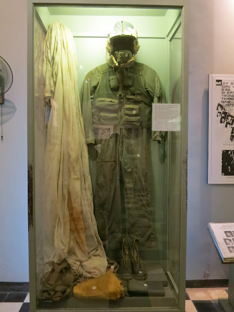 The captured flight suit and parachute of John McCain.