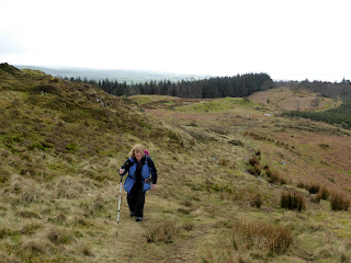 Ann approaches the top of Muncaster Fell