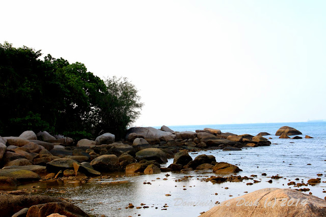 The rocks at the far end of the beach