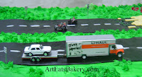 Moving to kansas Groom's cake with Wizard of Oz characters, edible Emerald City, Wicked witches feet, cars, motorcycles and u-haul 3