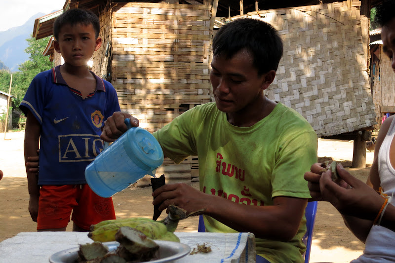 Pouring Lao Lao (homemade rice whiskey) into the goat's horn