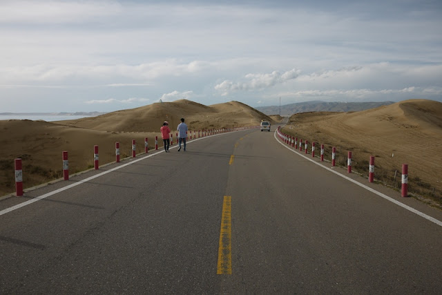 road scene with sand dunes in Qinghai, China