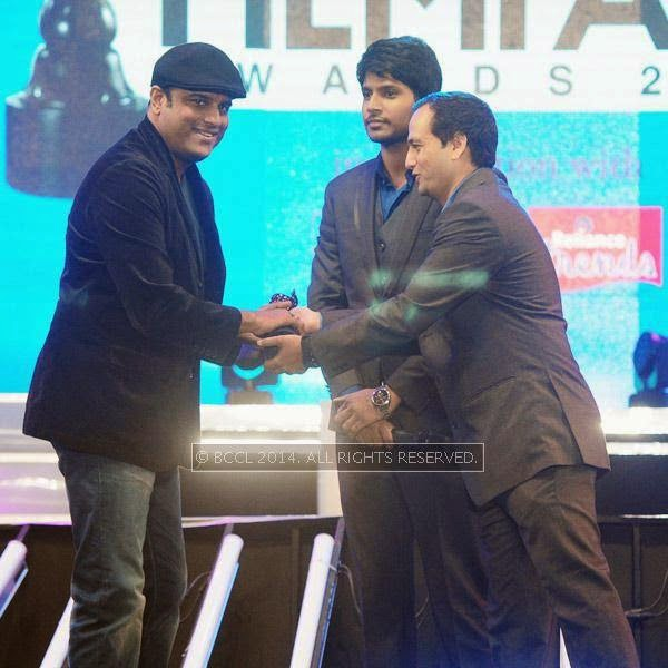 Murali Gopi receives Best Actor in the Supporting Role (Male)  Award for his performance in 'Left Right Left' during the 61st Idea Filmfare Awards South, held at Jawaharlal Nehru Stadium in Chennai, on July 12, 2014.