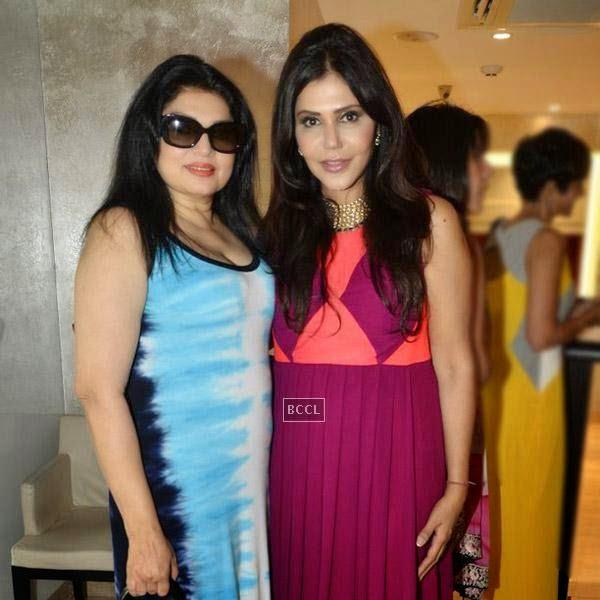 Kiran Juneja and Nisha Jamwal pose for a photo during the high tea party, held at Zoya on July 24, 2014.(Pic: Viral Bhayani)