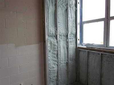 Spray foam applied to a wall in the high school lab