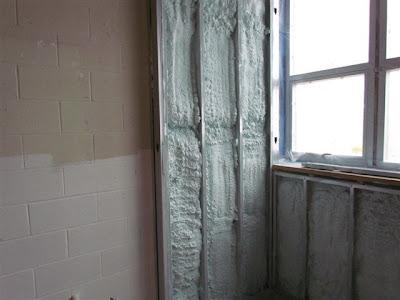 Spray foam applied to a wall in the high school lab