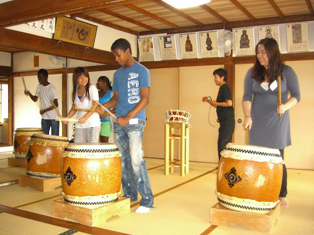 Students playing traditional Japanese drums during a Summer trip to Japan