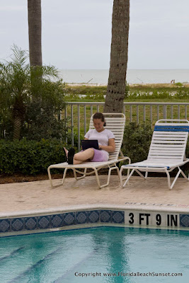 Relaxing by the pool with the Gulf in the background