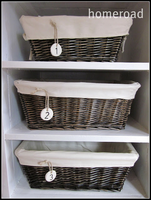 Three stacked baskets with clay hanging tags