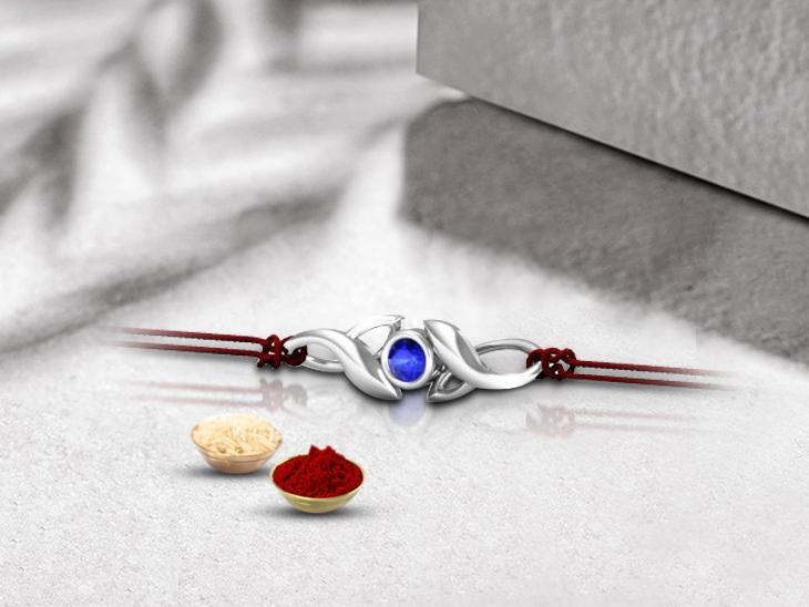 sleek silver rakhi pendant