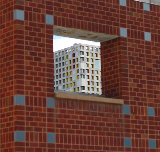 a corner of Spongebob Squaredorm as seen through a hole in a wall that may have been designed with that view in mind