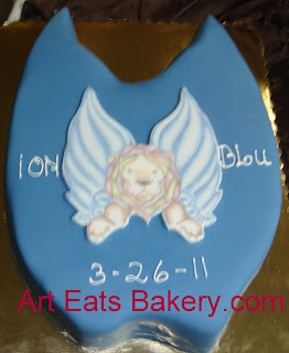 Ion Blu Clothing line launch party fondant cake with winged lion logo
