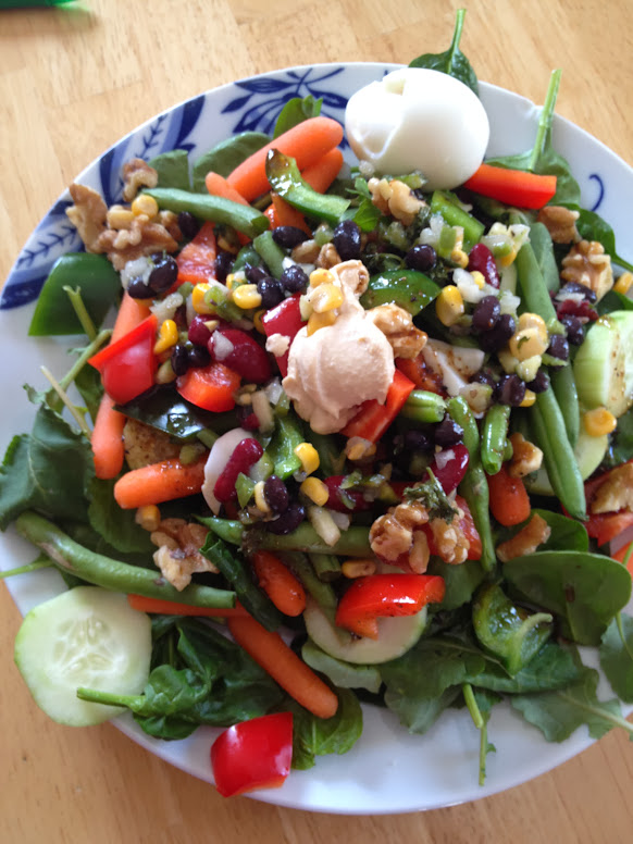 Salad with egg, beans, and nuts