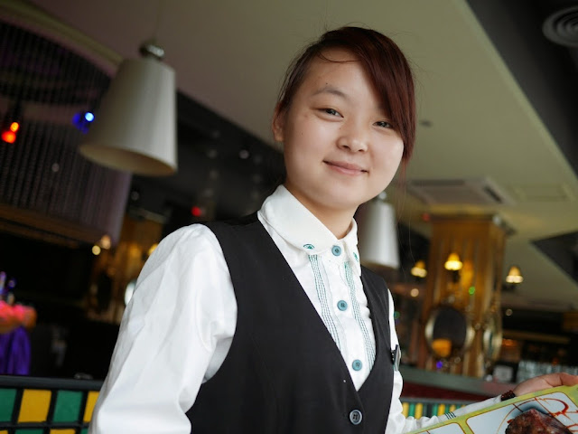 waitress at the Greenery Cafe in Zhanjiang
