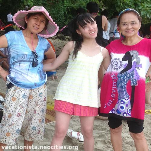 Wawa, Alexia, Trisna pose smiling on the white sand