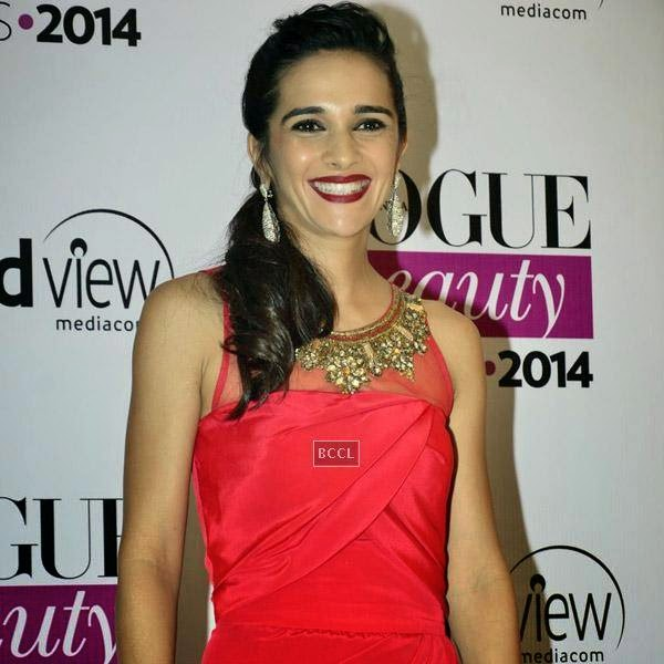 Tara Sharma smiles as she arrives for Vogue Beauty Awards 2014, held at Hotel Taj Lands End in Mumbai, on July 22, 2014.(Pic: Viral Bhayani)