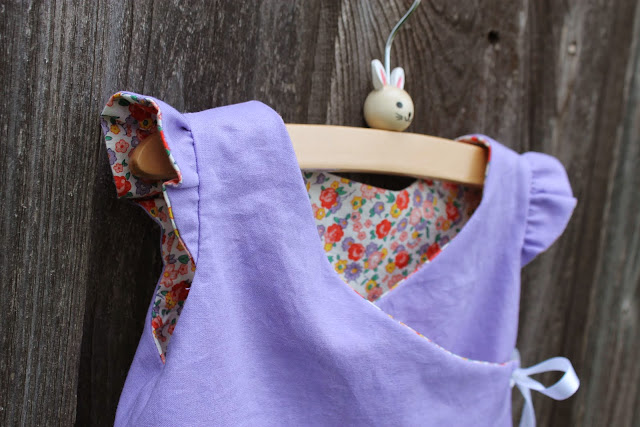 reversible wrap top with kitty emroidery