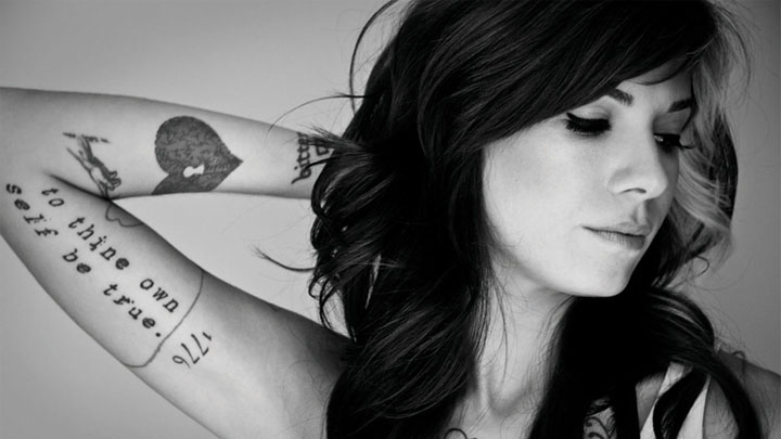Christina Perri shows of her heart-shaped tattoo