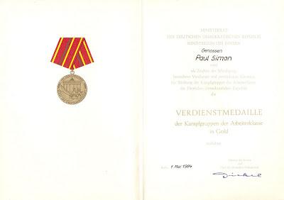183 e Verdienstmedaille der Kampfgruppen der Arbeiterklasse in Gold www.ddrmedailles.nl