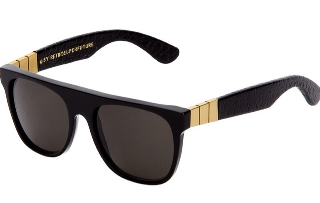 7cfa15ce5018 Rihanna began her look today with Super s Spring 2013 black and gold flat  top sunglasses. We last discussed this brand when her little brother Rajad  wore a ...