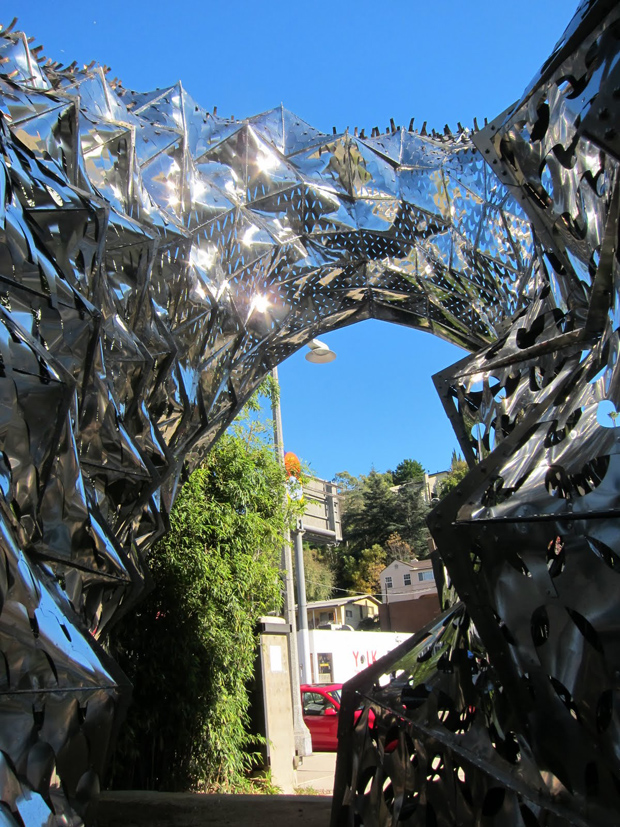 Metal Flower Installation Tracks The Heat Of The Sun