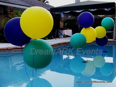 Backyard party decoration, balloons clusters in swimming pool