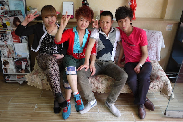 four young people wearing a variety of fashions sitting on a couch in Yinchuan, China