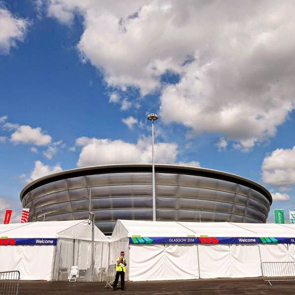 A guard stands outside the security perimeter of the SSE Hydro in Glasgow, Scotland, July 22, 2014. The SSE Hydro is part of the Scottish Exhibition and Conference Centre (SECC) Precinct, the host venue for six competitions - gymnastics, boxing, judo, netball, wrestling and weightlifting/powerlifting - of the Glasgow 2014 Commonwealth Games.