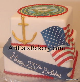 Two tier square custom red, white and blue U.S. Navy birthday cake design idea with gold anchor, Navy emblem and edible American flag