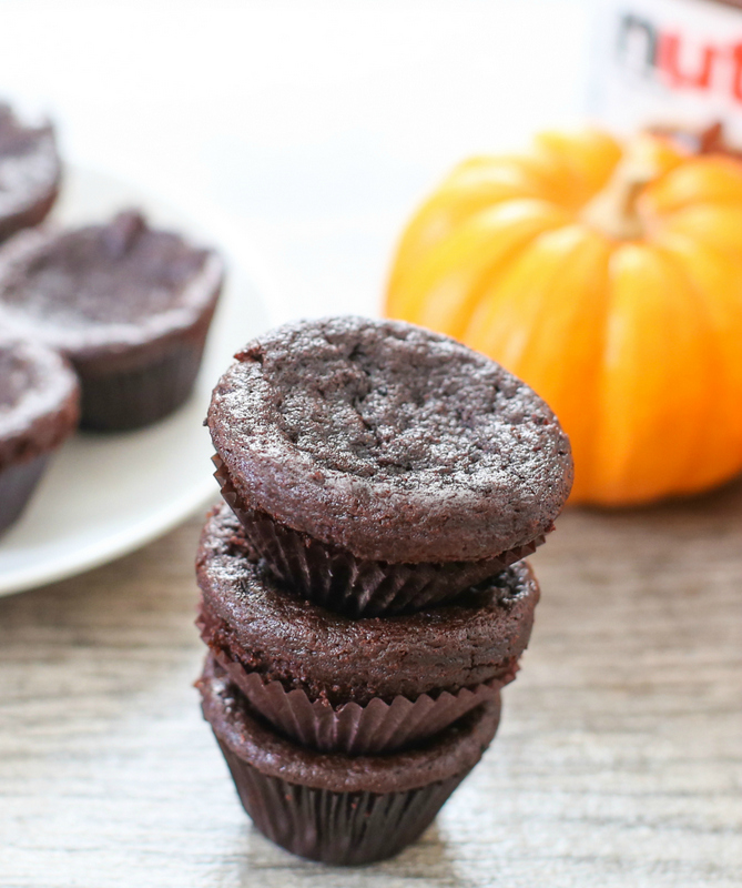 photo of a stack of three Flourless Nutella Pumpkin Muffins