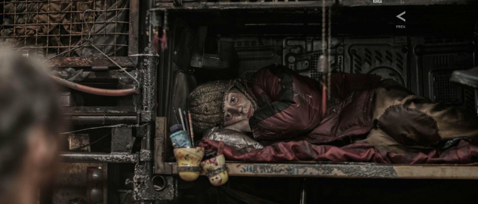 snowpiercer-huddled-passenger.jpg