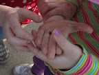 "Children hold a ""roly-poly"" for close observation."