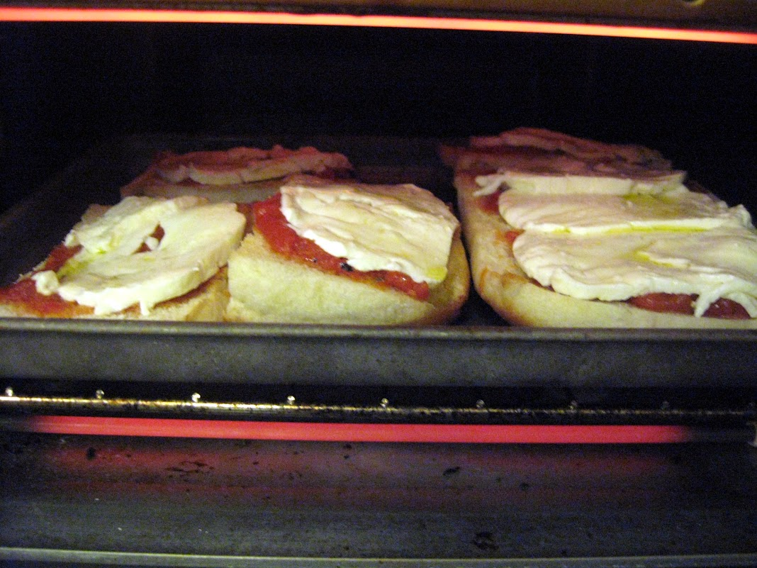 Pizzas assembled and placed in the toaster oven
